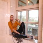 W320 Eileen in jeans and yellow top taking a bath