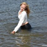 W335 Eileen in leather pants and white blouse in the river