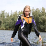 W337 Eileen in a lake in Fila tracksuit and leggings