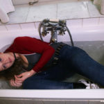 W182 Eileen in jeans and sweater in the bath