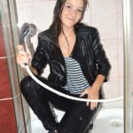 W194 Evelyn in leather jacket under the shower
