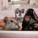 ST006 Eileen ripping a dress in the bath