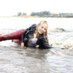 W235 Eileen in red leather pants in the river