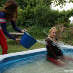 W244 Leila pushing Eileen in the pool in a catsuit