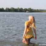 W249 Eileen enjoying a summer day at the river in a yellow dress