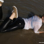 W310 Eileen in the river in tight pants and white blouse