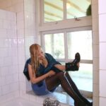 W315 Eileen in jeans skirt and jacket taking a bath