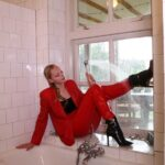 W326 Eileen in red business suit showering after a hard day at work