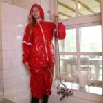W328 Eileen in red Agu raingear getting wet