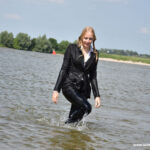 W333 Eileen in black business suit in the river