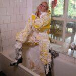 W341 Eileen in yellow raingear with shaving foam